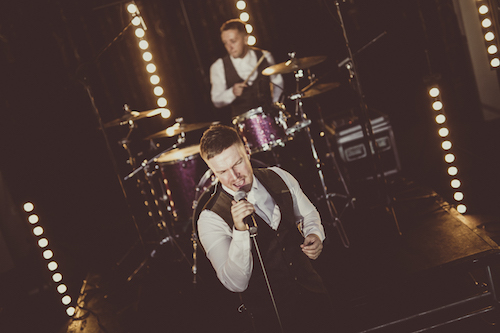 Lead singer Mike from Audio Sugar band for wedding reception singing a First Dance at a St Tewdwrics House Chepstow