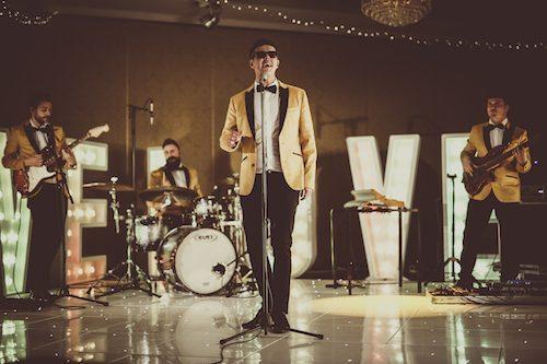 Lead singer Gavin leading wedding music band 24K